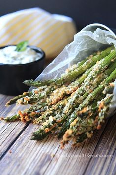 A healthy alternative to French Fries... Baked Asparagus Fries with Lemon Herb Aioli | www.joyfulhealthyeats.com