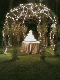 Outdoor wedding cake table with lights