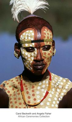 Africa | Karo man with body painted in ochre, yellow and white paint.  Omo Valley, Ethiopia | ©Carol Beckwith and Angela Fisher