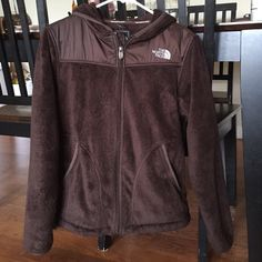 Discontinued Brown Hooded North Face Jacket!!! Amazing North Face jacket. Wish I didn't have to part with it, but I just have so darn many! Absolute perfect condition. There is elastic to tighten bottom if you want to. It is a size Medium, but I wear an xs/s because I like them loose, so this will definitely fit xs-l depending on how you like it. Only thing is on the inside (4th picture) my name is on the tag by the pocket & pilling on the pocket lining, which I think is typical of NF…