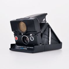 Awesome Black label Polaroid SX-70 Sonar by the Impossible Project     OPENING HOURS  Monday - Friday 11:00am to 7:00pm  Saturday and Sunday 12:00pm to 6:00pm  CONTACT  425 Broadway, 5th Floor  New York, NY 10013  USA  (212) 219-3254 / (888) 250-6020  nyc@the-impossible-project.com