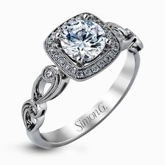 Reflecting a lovely romantic design  this white gold classic engagement ring features .16 ctw round cut white diamond accents.