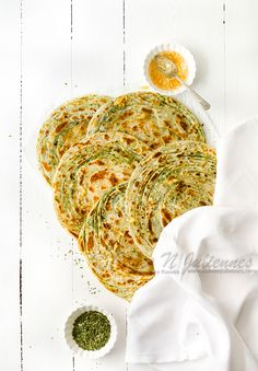 Restaurant style pudina paratha recipe with step by step photos. Pudina lachha paratha recipe or Mint paratha is crisp flaky Indian bread flavoured with dried mint (pudina in hindi). Indian Flat Bread, Indian Breads, Indian Food Recipes, Ethnic Recipes, Oriental Recipes, Indian Snacks, Paratha Recipes, Mint Recipes, Types Of Bread