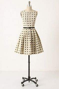 Neat as a pin; a dress for conquering small worlds.  Agressively sweet.