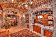 Rough stone walls and barrel-vaulted ceilings create a wine cellar with warmth and old-world charm. This European-style home rests on 4.5 acres in a serene, private enclave in California's Lake Arrowhead community.
