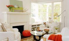 crisp white + rich orange in living room via sunset magazine