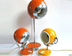 Robotic - The sunshine family, 1970 vintage space age Globe lamps. Atomic design. €160.00, via Etsy.