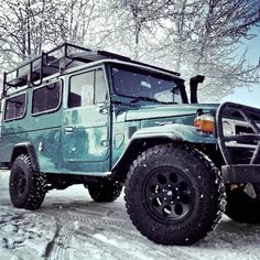 Green Toyota Land Cruiser FJ45 in the Snow