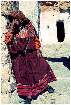 Africa: Amazigh berber woman outside her small home, Tunisia