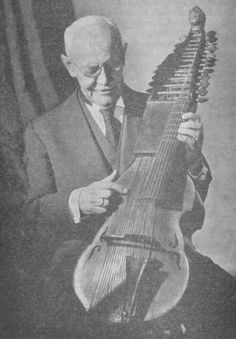 A photograph of Christian Döbereiner, examining a baryton in the museum in Munich. In addition to championing the viol in Germany and the USA, Mr. Döbereiner also authored one of the first tutors for playing on the viol da gamba, which was published very early into the 20th C. He edited a substantial number of works for the viola da gamba and for the baryton.