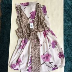 NWT Summer Maxi Dress Brown leopard-print top with lavender flowers on the bottom. Ties at chest, adjustable for coverage. Never worn. Dresses Maxi