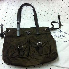 Prada brown bag Brown bag. Outside 2 pockets like in pix. Inside, one zipper pocket. Brand new. Never been use. 12x9 added new pics. Very cute bag Prada Bags