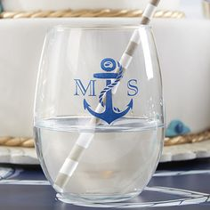 Nautical stemless wine glasses are personalized with an anchor or rope design along with your names or monogram. Set a glass out at each guest place setting or at the bar for guests to take home with them as reminders of your special day.