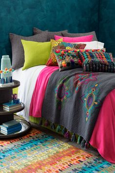 Mix it up with our Bright Bohemian collection of decorative pillows and accessories—including our Boho and Geodesic pillows, and our beautifully embroidered Kartika bed scarf, that was made to partner with lots of colors of our popular Boyfriend Matelassé Bedding. The festive finish: our Paint Chip Micro-Hooked wool rug.