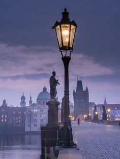 Prague, Czech Republic - Awesome place to visit.  I've been on this bridge.  Art students will sit on the bridge and draw/paint the statues