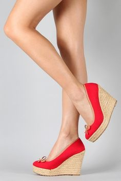 super cute casual summer wedge -- but I seriously wonder if I could walk in these! :)