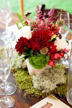Dahlia and rose centerpiece with moss