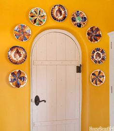"An original door is crowned with a collection of vintage plates from Oaxaca, Mexico. ""A nice example of common pottery,"" Espinar says. ""I like the way the glazes bleed into each other."""