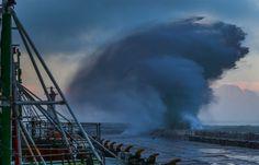 Breaking wave sends water sky high (Photo: Nic Bothma / EPA)