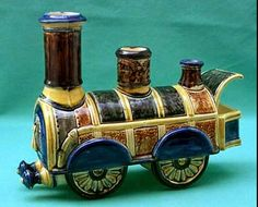 Figural locomotive ashtray,  with 'chimneys' for escaping cigar smoke. Wasmuel, Belgium. Info and image from Glazed and Confused blog.
