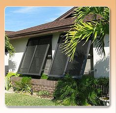 Protect your Florida home this hurricane season with Alufab USA's Bahamas Shutters. These shutters will work for you all year round and beautify your home at the same time. Bermuda Shutters, Bahama Shutters, House Shutters, Interior Shutters, Window Shutters, Beach Porch, Beach House, California Shutters, Modern Farmhouse Exterior