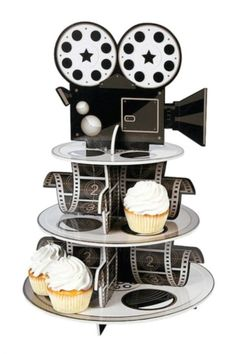 You are absolutely going to love this movie reel cupcake stand that we found. It will give your movie night party some Hollywood flare and look amazing on your dessert table. See more party ideas and share yours at CatchMyParty.com #catchmyparty #partyideas #movienight #movienightparty #moviereelcupcakestand