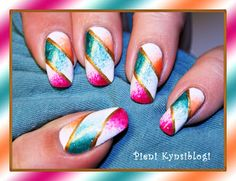 Nail art design in bright colors sponged on after using tape
