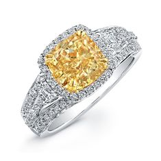 Natalie K Design no.NK20599FY-WY   A center cushion cut fancy yellow diamond center is surrounded by 100 round white diamonds and 2 trapezoid side diamonds in this fancy yellow diamond ring.
