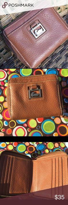 Dooney Bourke zip wallet Caramel brown Dooney Bourke leather zip wallet.  I also have Coach & Michael Kors in my closet 😬 Dooney & Bourke Bags Wallets