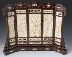 """CHINESE CARVED IVORY & ROSEWOOD TABLE SCREEN Intricately carved ivory and rosewood table screen, late 19th C. Five central panels, each telling a piece of a narrative. Decorative ivory pieces adorn the top and bottom of the rosewood frame. The narrative panels range from 7-8"""". The wooden frame also features some small gold line details. Provenance: Private Florida collection. Weight: 7.4 lbs Size: 20.5 x 17"""""""