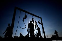 ANNAPOLIS, MD - MAY 13: Members of the United States Naval Academy freshman class climb ropes on a obstacle course during the annual Sea Trials training exercise. For 14 hours, the United States Naval Academy freshman class, also known as Plebes, worked as a team to complete many grueling physical and mental challenges. Of the challenges, they endured: a two-mile regimental run, ground fights, water tactics, aquatics challenges, and survival skills, amongst many others.