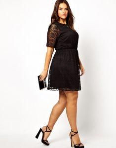 (Foto 24 de 25) Vestido de fiesta realizado en encaje de color negro, Galeria de fotos de 25 vestidos cortos para mujeres un poco más gorditas
