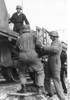 German crew prepares railroad naval gun for action near San Remo, Italy, October 1944.