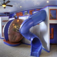 football conceals ladder -hey.. can't fall off it with those protective sides!  slide to get up in the morning!.. looks like a pole on the side as well.  Is this strictly a play area or is there a bed up there? Crazy Kids' Rooms That Are Supercool | POPSUGAR Moms