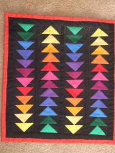 Color wheel triangles on black Quilt
