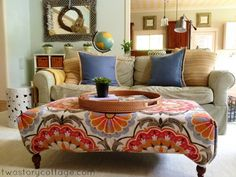 Colorful upholstered stool.  Plus the pillows and background reflect the colors.