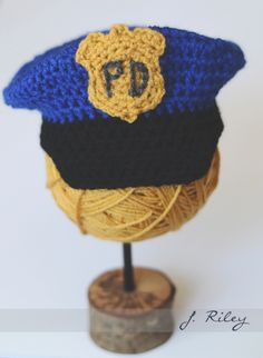 Crochet Police Hat. FREE Hat Pattern found at BustingStitches.