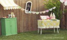cute backyard birthday party decor.  like the awning. tablecloth fits tight so it won't blow in the wind and is short enough so no one stumbles on it.