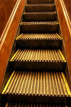 NYC. Manhattan. One set of Macy's wooden  // Built in 1902, Macy's Herald Square was the first building in the world to have the modern day escalator. The wooden escalators are still in use today!
