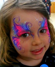 Beautiful little girl and awesome art with face paint and brush !! WOW