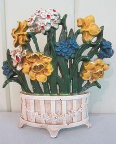 Hubley flower door stops - John Wright spring flowers cast iron doorstop with garland-decorated vase - Atticmag