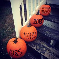 Such a cute fall pregnancy announcement!! His birth year, hers, their dog, and the baby!