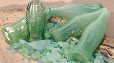 As the Coca-Cola bottle marks its anniversary, it has picked up a new set of admirers: the growing number of sea glass collectors who cherish its aquamarine green color and the nostalgia that comes with a century-old possession. Sea Glass Beach, Sea Glass Art, Stained Glass, Aqua Glass, Beach Stones, Old Glass Bottles, Glass Photography, Photography Ideas, Coca Cola Bottles