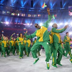 RIO DE JANEIRO, BRAZIL - AUGUST 05:  Members of the South Africa team take part in the Opening Ceremony of the Rio 2016 Olympic Games at…