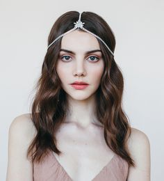 This Jennifer Behr Thea Diadem headpiece with Swarovski crystals is both simple and makes a statement! Gives off a glamorous bohemian vibe when worn in wavy hair. Our headpieces also make a statement with a pixie haircut.