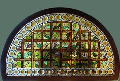 Antique American Semi-circular Morning Glory Window with a surround of amber Rondels. Price: $12,500.00