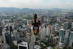 Base jumper Malachi Templeton from New Zealand leaps from the top of the 421-meter Kuala Lumpur Tower during the International Tower Jump in Kuala Lumpur. (AFP)
