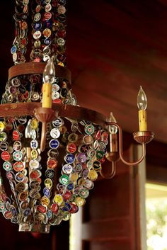 Beer-de-lier - i.e. a chandelier decorated with hundreds of beer bottle caps. Would look great in a pub