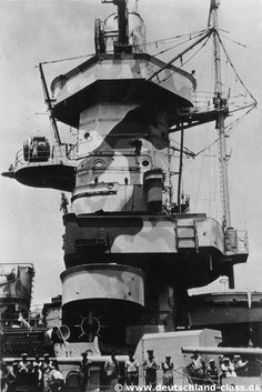 Admiral Graf Spee's bridge superstructure seen from the port side. Notice the shell damage in the bridge structure at the level of the searchlight platform.