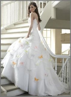 during the wedding my dress will be the classic white but for photos butterfies will